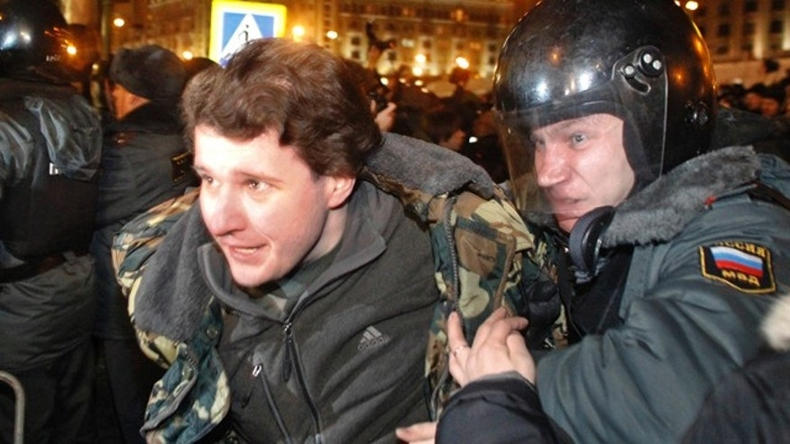 Dec. 6: Police detain a demonstrator during protests against alleged vote rigging in Russia's parliamentary elections in Moscow.