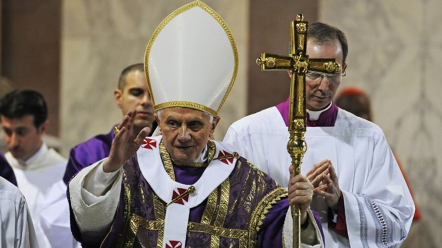 March 9: Pope Benedict XVI salutes the faithful during the traditional Ash Wednesday mass in the St. Sabina church in Rome.