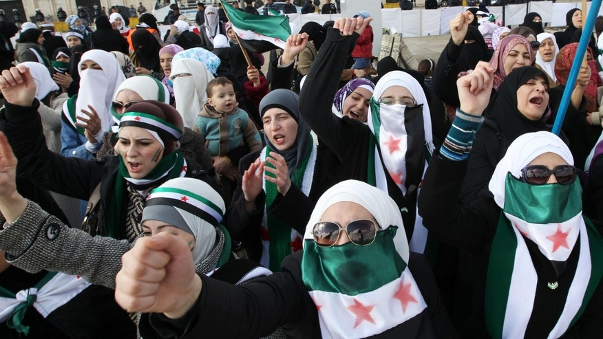 Dec. 9, 2011: Syrians living in Jordan shout slogans during a demonstration against Syrian President Bashar al-Assad after Friday prayers in front of the Syrian Embassy in Amman.