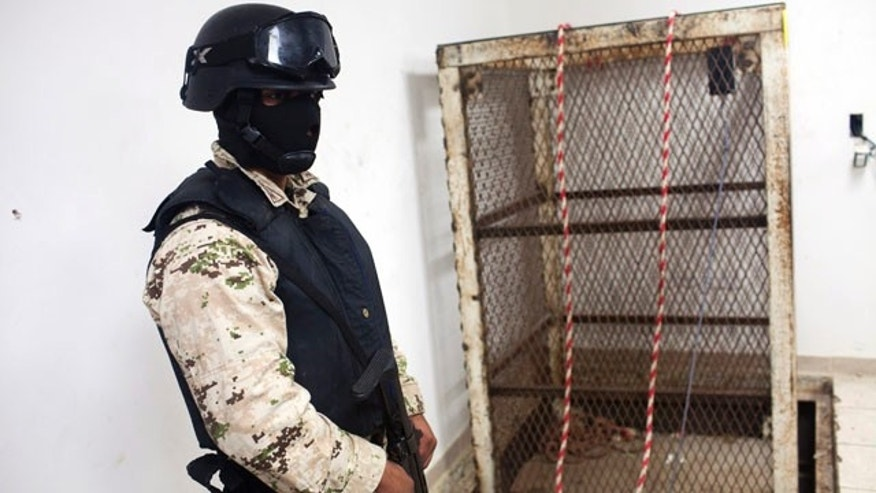 Nov. 30, 2011: A Mexican army soldier stands next to an elevator shaft that lowers into a tunnel in the northern border city of Tijuana, Mexico. U.S. authorities said they discovered a new cross-border tunnel Tuesday, the latest in a spate of secret passages found to smuggle drugs from Mexico. The tunnel was found in San Diego's Otay Mesa area, a warehouse district across the border from Tijuana, said Lauren Mack, a spokeswoman for U.S. Immigration and Customs Enforcement.