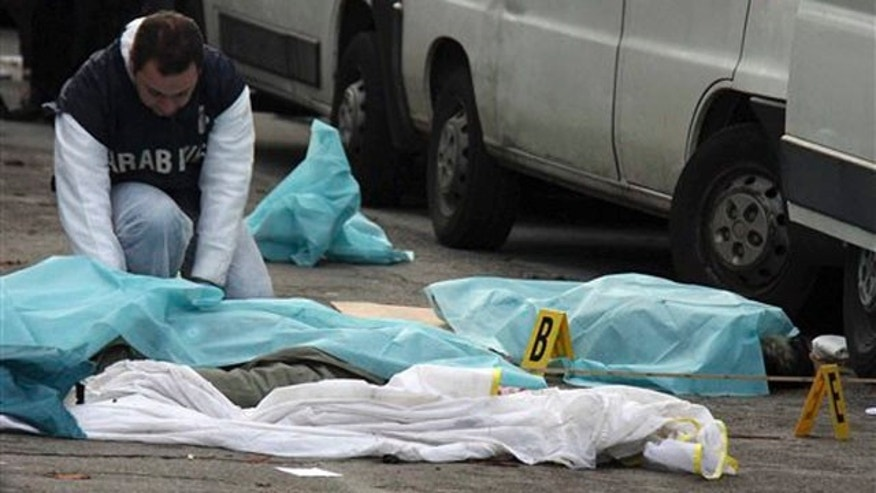 Dec. 13, 2011: A forensic police officer checks the scene after an Italian man with extreme right-wing views opened fire in an outdoor market in Florence, Italy.