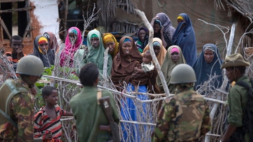 Dec. 13: Female villagers speak to soldiers from both the Kenyan army and a Kenyan-allied Somali militia, in Ras Kamboni, southern Somalia.
