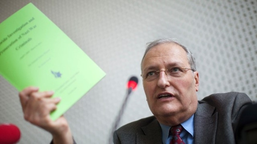 Dec. 14: Efraim Zuroff, chief-Nazi hunter of the Simon Wiesenthal Center and director of the Center's Jerusalem Office, gestures during a news conference in Berlin.