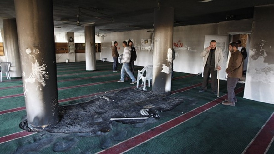 Dec. 15: Palestinians examine the damage at a mosque in the West Bank Village of Burqa near Ramallah.