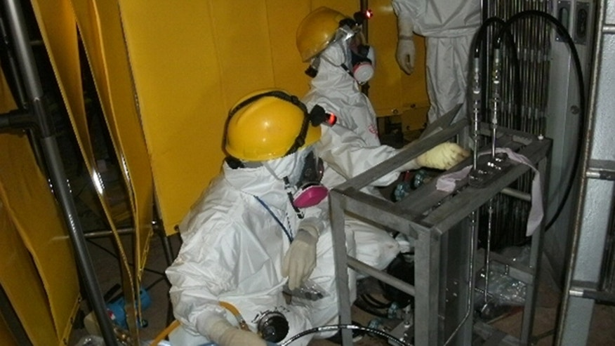 June 3: Workers try to install a pressure indicator inside the Unit 1 reactor at Fukushima Dai-ichi nuclear power plant in Okuma, Fukushima Prefecture, northern Japan.