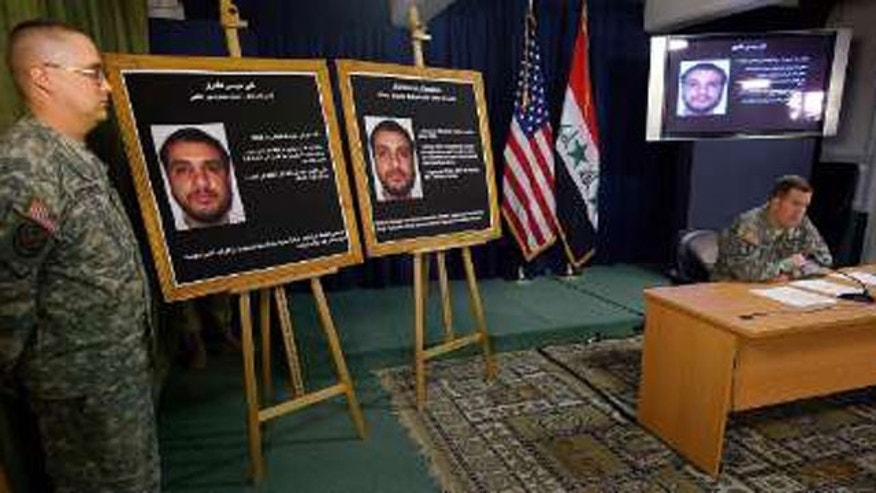 Brigadier-General Kevin J. Bergner, U.S. military spokesman in Iraq, speaks to the media next to a picture of Ali Mussa Daqduq, a captured senior Lebanese Hezbollah operative, at the heavily fortified Green Zone area in Baghdad July 2, 2007.