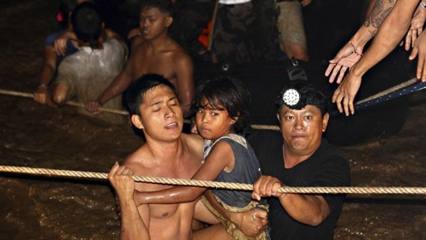 December 17, 2011: Residents are rescued by volunteers following a flash flood that inundated Cagayan de Oro city, Philippines.