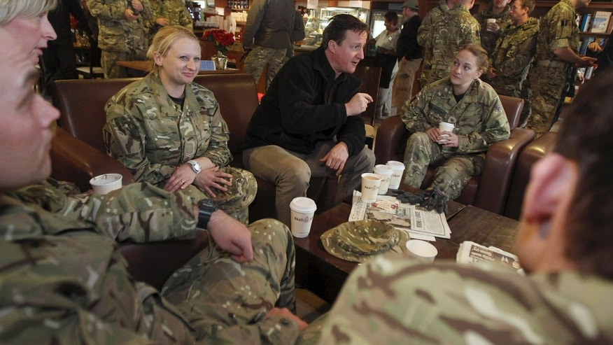 December 20: British Prime Minister David Cameron, center, meets with British soldiers at Kandahar airfield, Afghanistan.