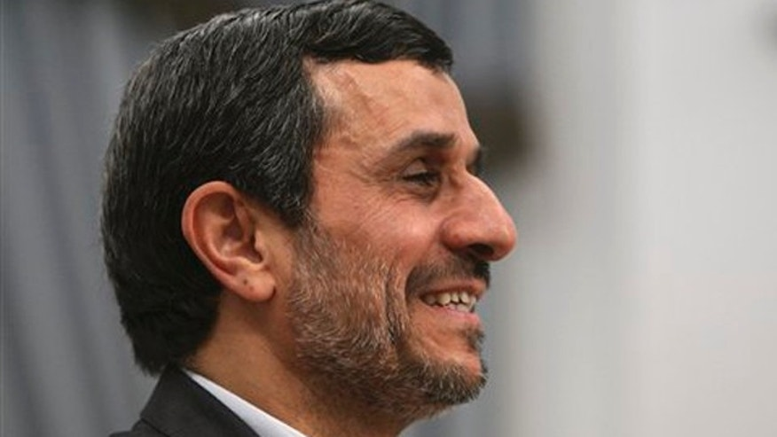 Dec. 13, 2011: Iranian President Mahmoud Ahmadinejad, smiles, prior to a meeting at the presidency office in Tehran, Iran.
