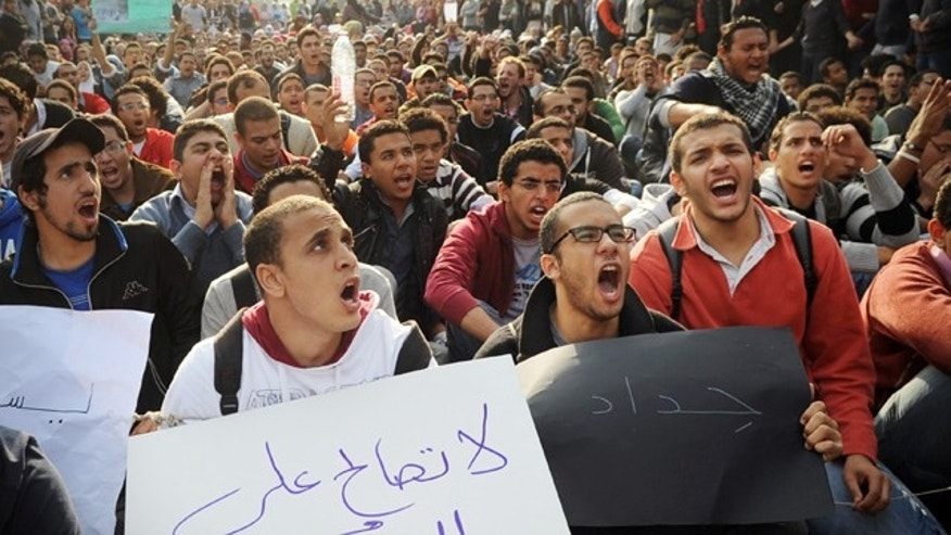 Dec. 21: Egyptian men chant slogans during a protest demanding the military step down in Cairo.