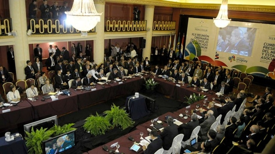 Leaders attend the Mercosur summit in Montevideo, Uruguay,Tuesday, Dec. 20, 2011. South America's Mercosur trade bloc approved a Palestinian free trade deal Tuesday and then pushed to admit Venezuela as a full member, even at the cost of threatening its founding principles. (AP Photo/Matilde Campodonico)