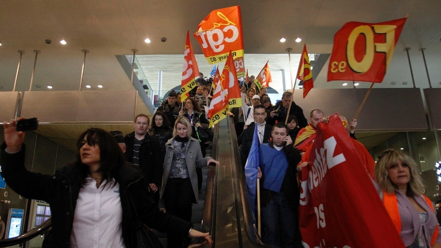 Dec. 22, 2011: Airport security personnel demonstrate to demand negotiations with management over an increase in pay, at Roissy Charles de Gaulle Airport, north of Paris.