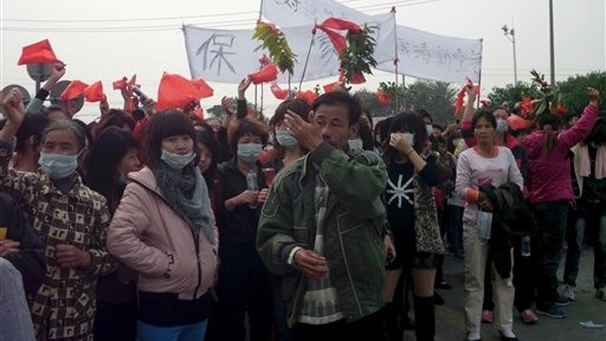 Dec. 23: Villagers gather to protest in Haimen, China.
