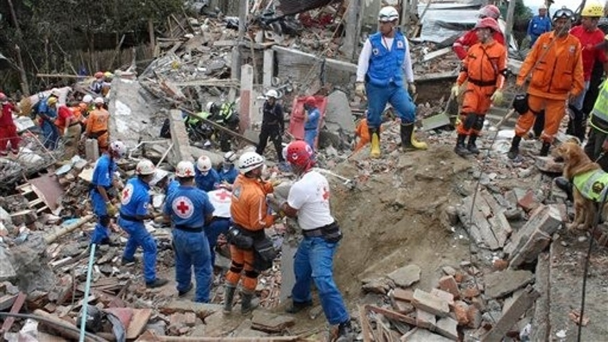 Dec. 23: Rescue workers search for survivors in the rubble of homes destroyed by a pipeline explosion in Dos Quebradas, Colombia.