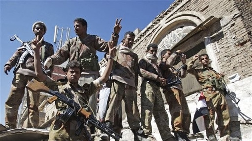 Dec. 25: Yemeni defected army soldiers gesture at protesters marching to demand the prosecution of Yemen's President Ali Abdullah Saleh in Sanaa, Yemen.
