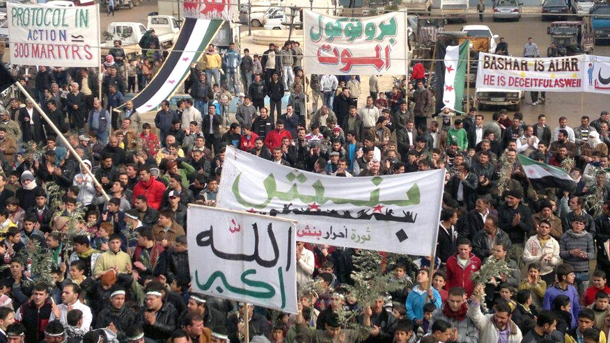 Dec. 23: Demonstrators protest against Syria's President Bashar al-Assad after Friday prayers in Binsh near Adlb