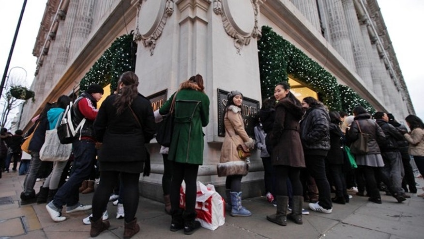 Dec. 26, 2011: People queue early in the morning outside a department store ahead of it opening for Boxing Day sales in central London.