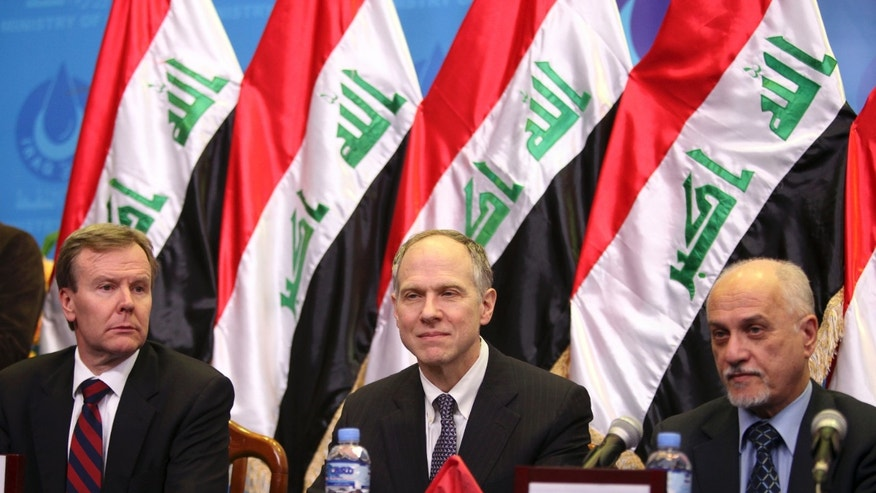 Jan. 25, 2010:  From left, ExxonMobil Corp. President Robert S. Franklin, ExxonMobil Corp. Director Richard C. Vierbuchen and then Iraqi Oil Minister Hussain al-Shahristani, are seen during a signing ceremony in Baghdad, Iraq. An oil exploration deal between U.S. oil giant Exxon Mobil and Iraq's autonomous Kurdish region is fueling political tensions in a country where a post-U.S.-troop withdrawal spike in violence and political turmoil is clouding the climate for foreign investments sorely needed by Iraq.