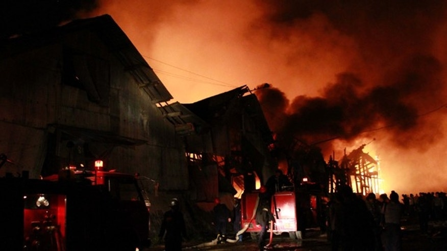 Dec. 29: Smoke and blaze rise from a warehouse in Pazundaung township, eastern Yangon suburb.