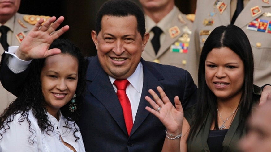 July 15: Venezuela President Hugo Chavez waves flanked by his daughters Rosa Virginia, right, and Gabriela, after he announced he will return to Cuba Saturday to begin a new phase of cancer treatment that will include chemotherapy at Miraflores presidential palace in Caracas, Venezuela.