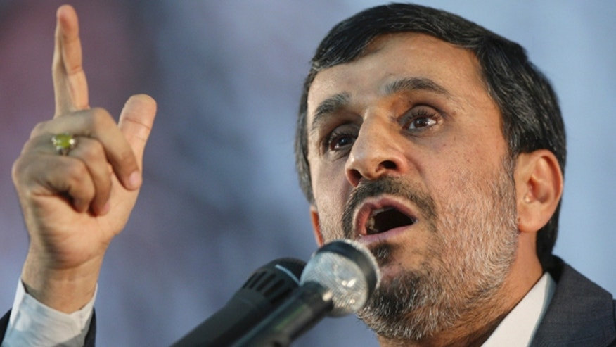 June 3: Iranian President Mahmoud Ahmadinejad gestures as he addresses the crowd at  a ceremony honoring late revolutionary founder Ayatollah Khomeini, on the eve of his 22nd death anniversary at his mausoleum, just outside Tehran, Iran.