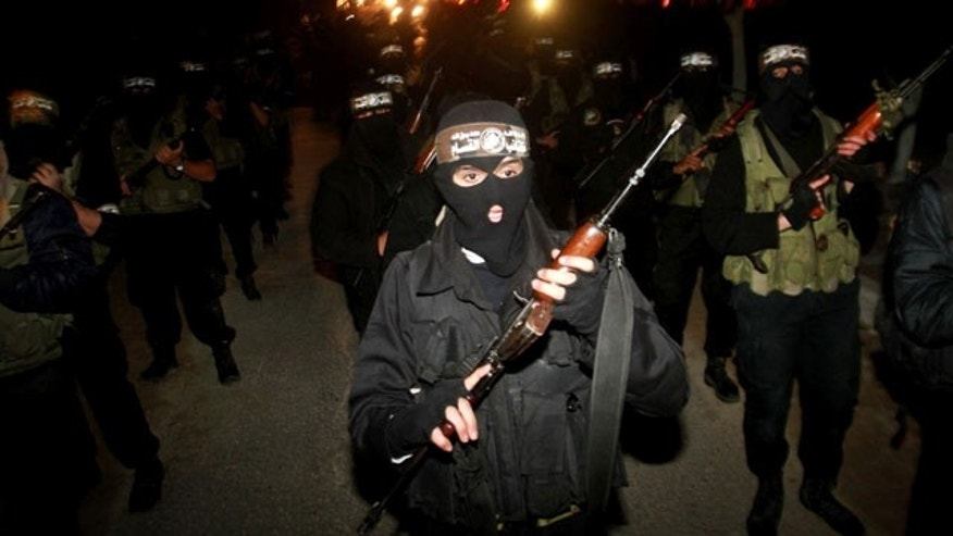 Dec. 27, 2011: Masked Hamas militants march with their guns during a parade to mark the third anniversary of the Israeli offensive on Gaza in 2008, in Gaza City.