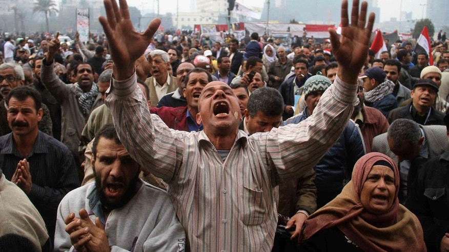 Dec. 30: Protesters chant slogans during a demonstration in Tahrir Square in Cairo, Egypt.