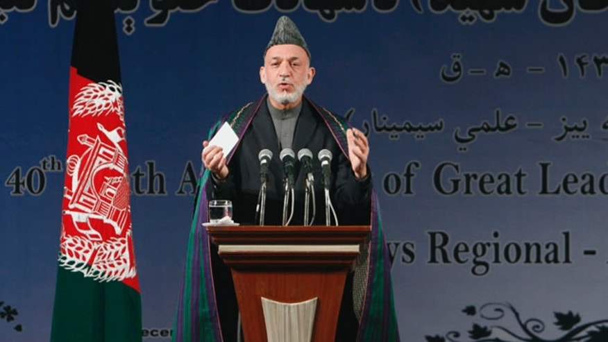 Dec. 31, 2011: Afghan President Hamid Karzai speaks during a gathering to mark the 40th death anniversary of political leader Khan Abdul Samad Khan Achekzai in Kabul, Afghanistan. Afghan President Hamid Karzai welcomed on Saturday remarks from the Obama administration saying that Taliban insurgents were not America's enemies.