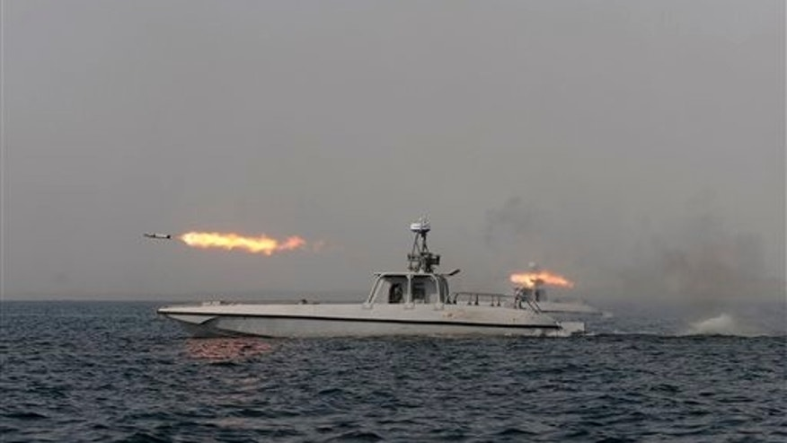 Dec. 30, 2011: An Iranian navy boat fires a missile in a drill in the sea of Oman.
