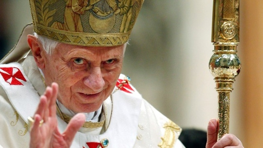 Jan. 1, 2012: Pope Benedict XVI blesses the faithful during a mass in St. Peter's Basilica at the Vatican.