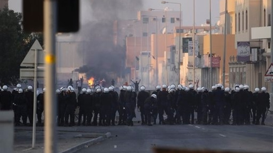 Jan. 1, 2012: Riot police and Bahraini anti-government protesters face off in the Shiite Muslim village of Sitra.