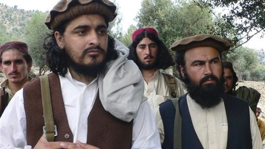 In this Sunday, Oct. 4, 2009 file photo, new Pakistani Taliban chief Hakimullah Mehsud, left, is seen with his comrade Waliur Rehman during his meeting with media in Sararogha of Pakistani tribal area of South Waziristan along the Afghanistan border. Prominent al-Qaida and Afghan Taliban fighters held recent meetings with Pakistani militants to ask them to set aside their differences and step up support for the battle against U.S.-led forces in Afghanistan, militant commanders said Monday, Jan. 2, 2012.