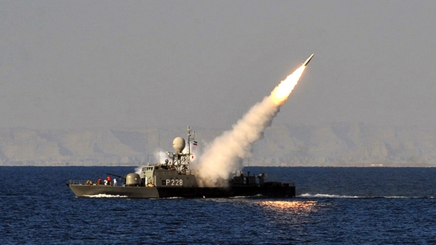 Jan. 1, 2012: In this image made available by the Iranian Students News Agency, an Iranian navy vessel launches a missile during a drill at the sea of Oman.