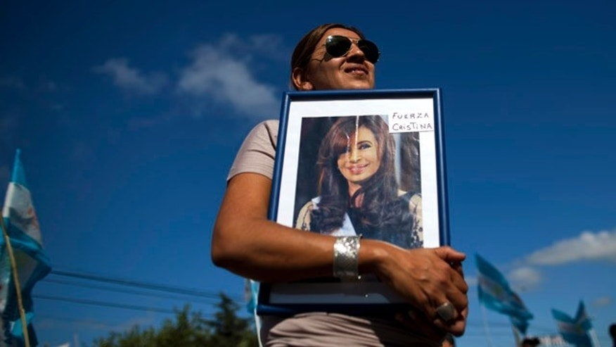 "Jan. 4, 2012: Rosa Calderon holds a picture of Argentina's President Cristina Fernandez that reads in Spanish ""Be strong Cristina"" outside the hospital where Fernandez will undergo surgery for thyroid cancer in Pilar, Argentina. The 58-year-old leader has papillary thyroid carcinoma, and her doctors said it was detected before it spread, so her condition should curable without chemotherapy. Vice President Amado Boudou will be in charge during the operation on Wednesday and for 20 days as she recovers."