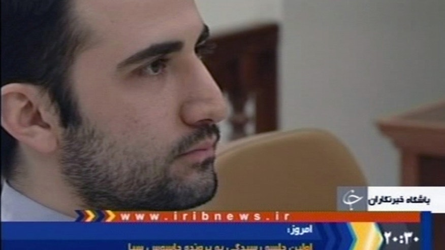 Dec. 27, 2011: In this video frame grab image made from the Iranian broadcaster IRIB TV,  U.S. citizen Amir Mirzaei Hekmati, accused by Iran of spying for the CIA, sits in Tehran's revolutionary court in Iran.
