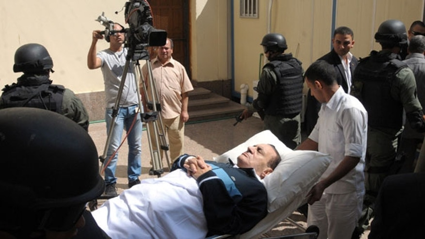Sept. 7: Former Egyptian president Hosni Mubarak lies on his bed while being taken to the courtroom for another session of his trial in Cairo, Egypt.
