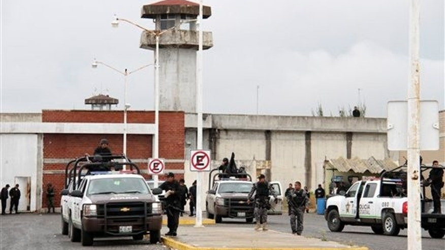 Jan. 5: Police stand outside the Altamira prison, in the town of Altamira, Mexico, after a prison riot broke out leaving 31 inmates dead.