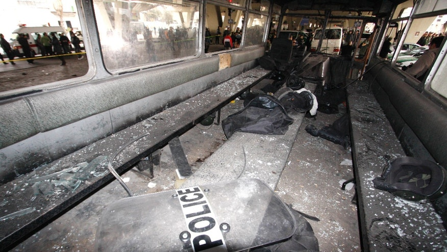 Jan. 6, 2012: Syrian riot police forces gear is seen inside a damaged bus at the scene bomb at Midan neighborhood, in Damascus, Syria.