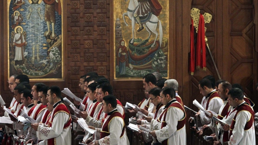Jan. 6, 2012: A choir sings during Christmas Eve mass at the Coptic Cathedral in Cairo, Egypt. Egypt's Christians celebrated Saturday their first Christmas after the ouster of President Hosni Mubarak, amid tight security and a display of national unity to allay fears of the growing power of Islamists.