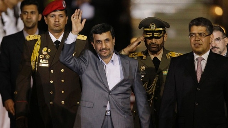Jan. 8, 2012: Iran's President Mahmoud Ahmadinejad waves upon his arrival at the international airport in Maiquetia, Venezuela.
