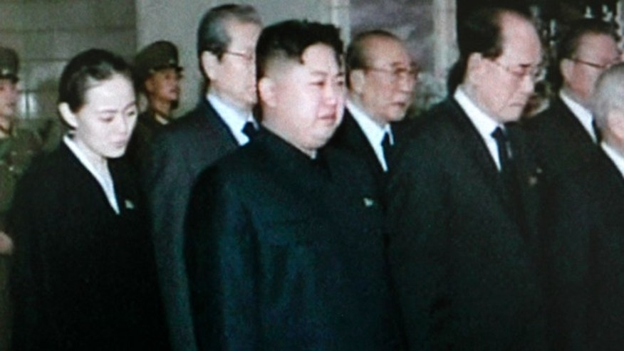 Dec. 26, 2011: In this image made from KRT television, Kim Jong Un, center, North Korea's next leader and the son of late leader Kim Jong Il, reacts as he pays respect to the body of his father in a glass coffin, not in photo, at Kumsusan Memorial Palace in Pyongyang, North Korea.