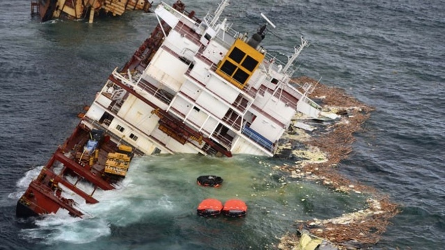 January 10, 2012: In this photo provided by Maritime New Zealand, half of the cargo ship Rena is partially submerged on a reef near Tauranga, New Zealand.