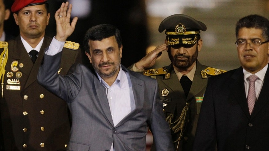 Iran's President Mahmoud Ahmadinejad waves upon his arrival at the international airport in Maiquetia, Venezuela, Sunday, Jan. 8, 2012. Ahmadinejad will visit Venezuela, Nicaragua, Cuba and Ecuador as part of a tour aimed at showing off relationships with some of Tehran's close allies while tensions grow over the country's threats to block oil shipments in retaliation for tighter U.S. sanctions. (AP Photo/Ariana Cubillos)
