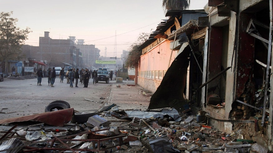 Jan. 10, 2012: Debris are seen at the scene of explosions in Jalalabad, Nangarhar province east of Kabul, Afghanistan.