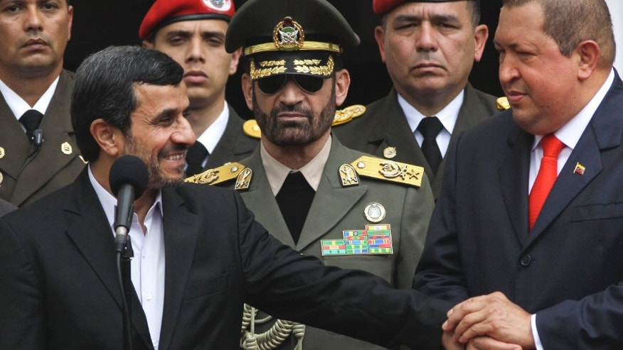 Venezuela's President Hugo Chavez holds the hand of Iran's President Mahmoud Ahmadinejad, left, during a welcoming ceremony at the Miraflores presidential palace in Caracas in January.
