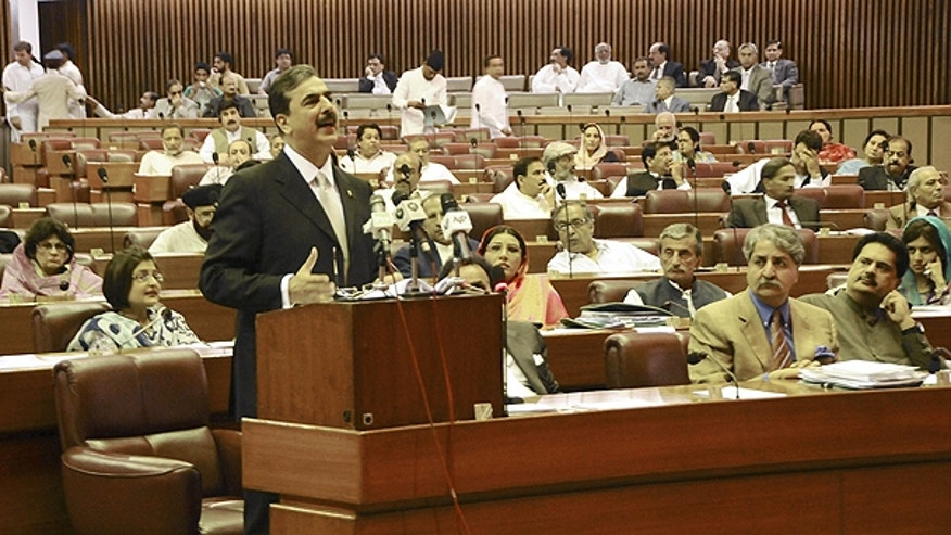 May 9: In this photo released by Pakistan's Press Information Department, Pakistani Prime Minister Yousuf Raza Gilani delivers a speech at the parliament house in Islamabad, Pakistan.