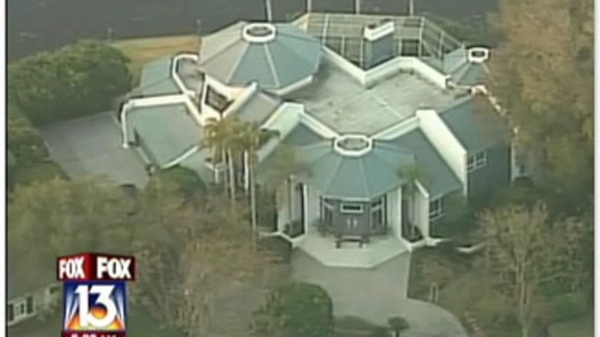 The Rivera's opulent home, where the two were found dead. They lived in an exclusive section of Tampa whose residents include former Tampa Bay Rays manager Lou Piniella.