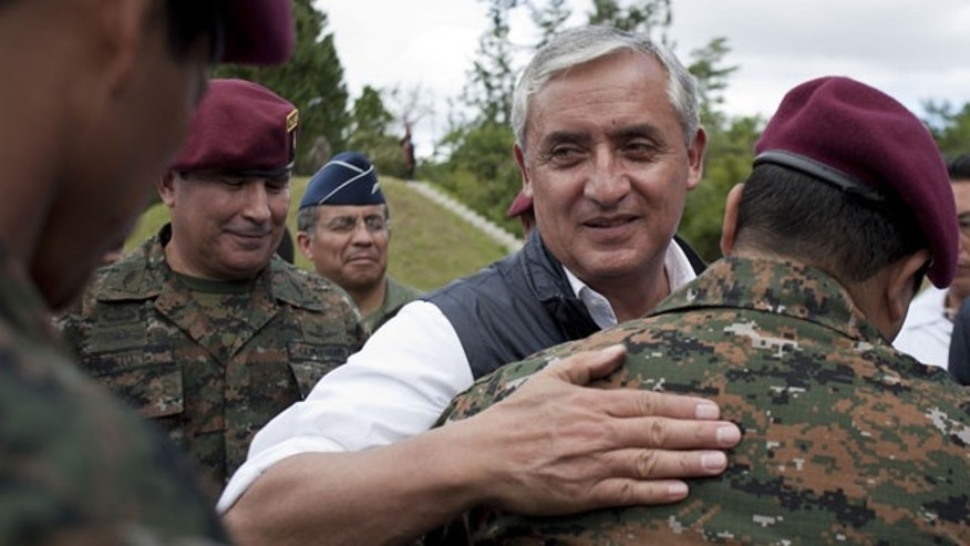 "In this Dec. 5, 2011 file photo, Guatemala's President-elect Otto Perez Molina, center right, greets new members of Guatemala's Army elite special forces, ""Kaibiles,"" at a graduation ceremony in Poptun, Guatemala."