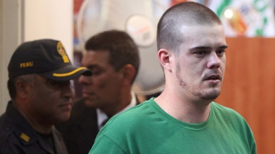 Joran van der Sloot sits in the courtroom before his sentencing at San Pedro prison in Lima, Peru, Friday Jan. 13, 2012.  Van der Sloot, 24, was sentenced for the 2010 murder of Stephany Flores, a young woman he met at a Lima casino. The Dutchman remains the prime suspect in the case of the unsolved disappearance of U.S. teen Natalee Holloway on the Caribbean island of Aruba.  (AP Photo/Karel Navarro)