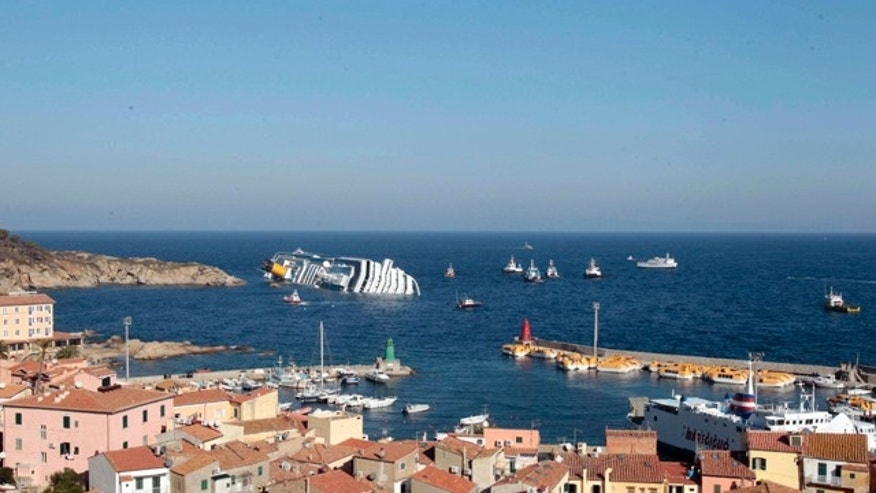 Jan 14, 2012: The luxury cruise ship Costa Concordia leans on its starboard side off the port at Giglio after running aground on the tiny Tuscan island of Giglio, Italy.